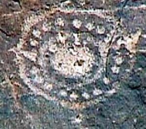 petroglyphs spots inside dots circles sun gods flowers
