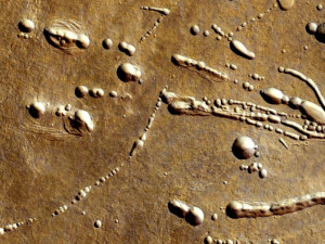 crater chains pits pluto electric EDM spark eroding