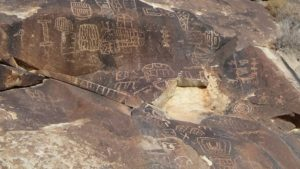 petroglyphs rock art squatter man boxes
