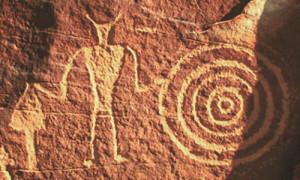 petroglyphs squatting man shape evolution plasma discharge