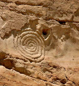 petroglyphs rock faces cliffs walls surfaces